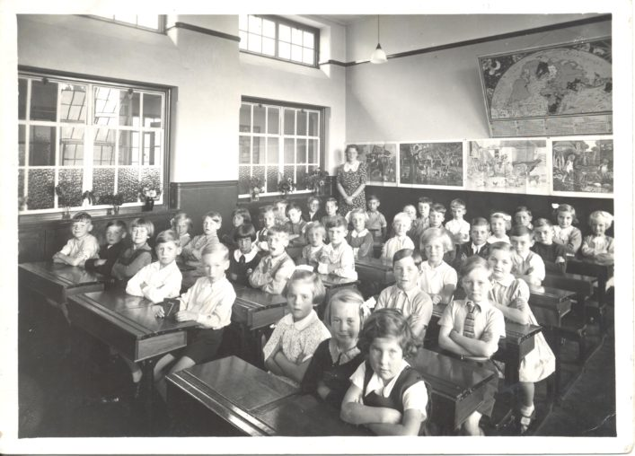 This photo of Jean West's (nee Birchall)  is taken in 1939.  The teacher is Miss Legeton , who later married Mr Dawes the Deputy Headmaster.
