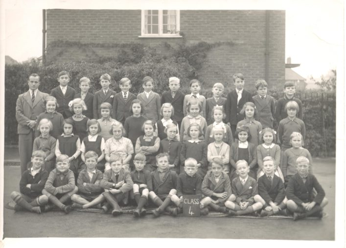 Another of Jean West's class photos taken in 1940.   Jean is sitting in the third row, second from the left.  Mr Pomfrey  is the teacher before he was called up for the War.