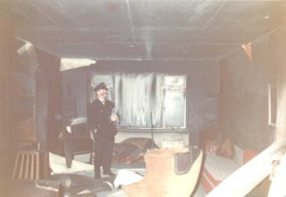 Fireman inspecting the damage | Bill Hinckley