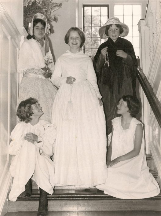 Another re-enactment pageant children photographed on the school staircase.
