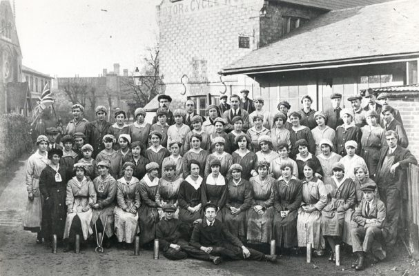 Staff at the munitions factory Jens is standing on the right with his left arm resting on a board | From the archives Hatfield Library