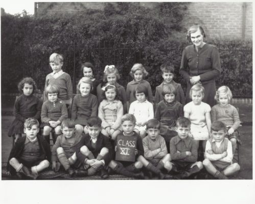 Class X1 with Miss Plumb. Do you recognise any of the pupils? What is the year?