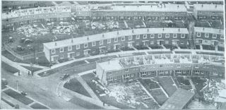 Houses in two rows at Hatfield had their roofs blown off by the gale. The row between with the roofs sloping in the opposite direction, was undamaged | The Times newspaper, Tuesday November 5 1957 page 18