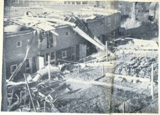 Looking down from a verandah on flats in Robins Way. A bomb could not have done more damage | Herts Advertiser, 8 November 1957 page 3
