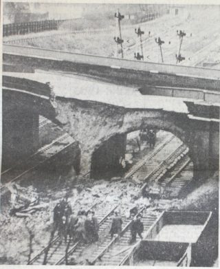 View of the blocked railway line at Hatfield and the collapsed bridge | Hertfordshire Mercury, 25 February 1966, page 1