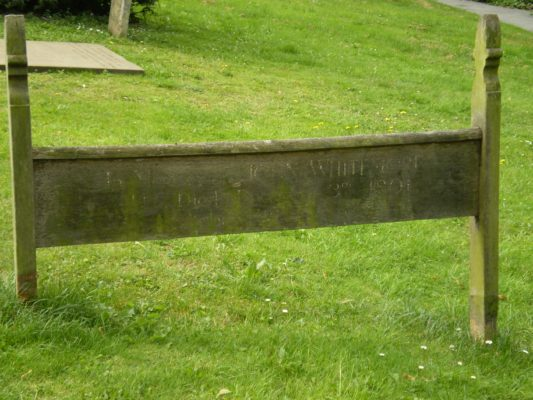13) In the churchyard can be found the wooden grave marker of John Whitmore. | Jean Cross