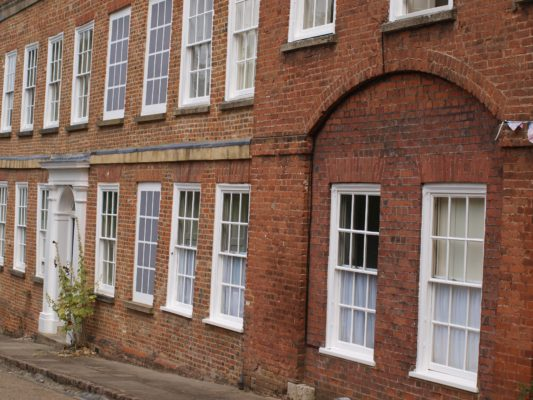 17) The first building below the gateway was the old Salisbury Arms Coaching Inn. You can see the old entrance and exit archways of the inn and also some blocked up windows (a legacy of the Window Tax). | Jean Cross