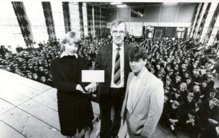 Head boy (Michael Evens) and Head girl (Karen Hudley) presenting a cheque to Mr Dummer of Hatfield branch of Save the Children fund for Ethiopia famine appeal 1985. | Hatfield Library
