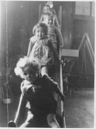 Children at the nursery in the St Johns Ambulance Building, Brian McCoy in the front. c1940 | Brian McCoy
