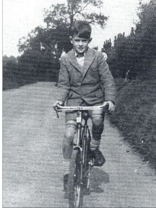 Cycling to school along the once-narrow, hedge-lined old Roe Green Lane before the war. This road is now re-named College Lane