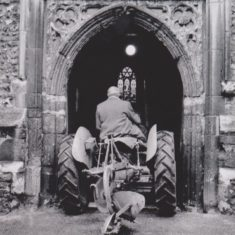 Percy Peppit driving tractor into St Eth's